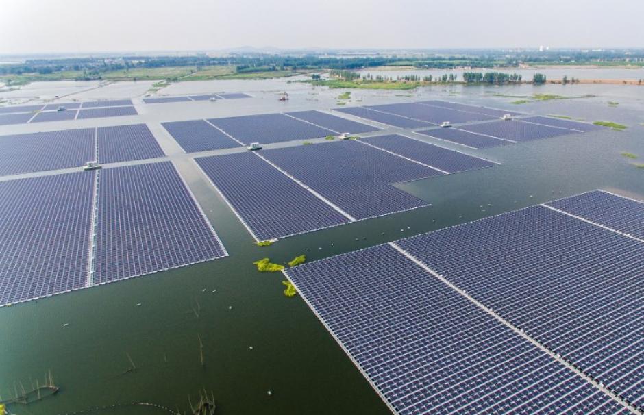 Singapore unveils one of the world's biggest floating solar panel farms | ప్రపంచంలోని అతిపెద్ద తేలియాడే సోలార్ ప్యానెల్ ఫామ్లలో ఒకదాన్ని ఆవిష్కరించిన సింగపూర్ |_40.1